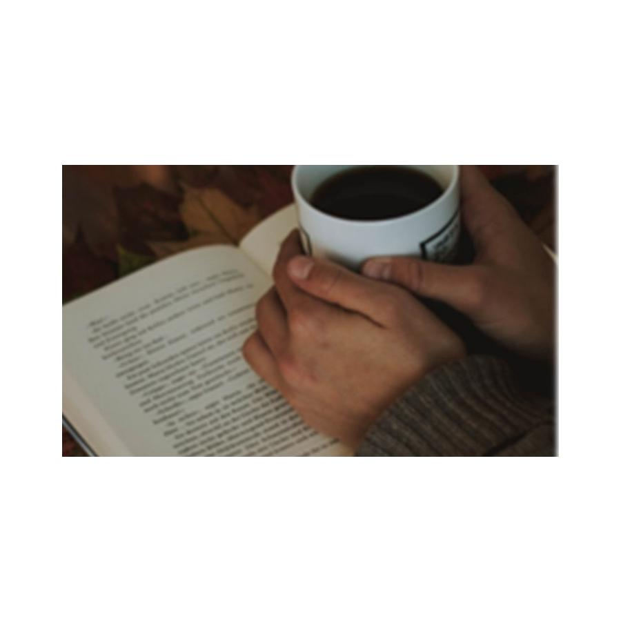 Coffee cup on a book