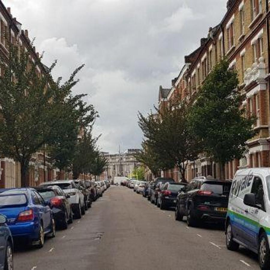 Parked cars on a road in Brixton