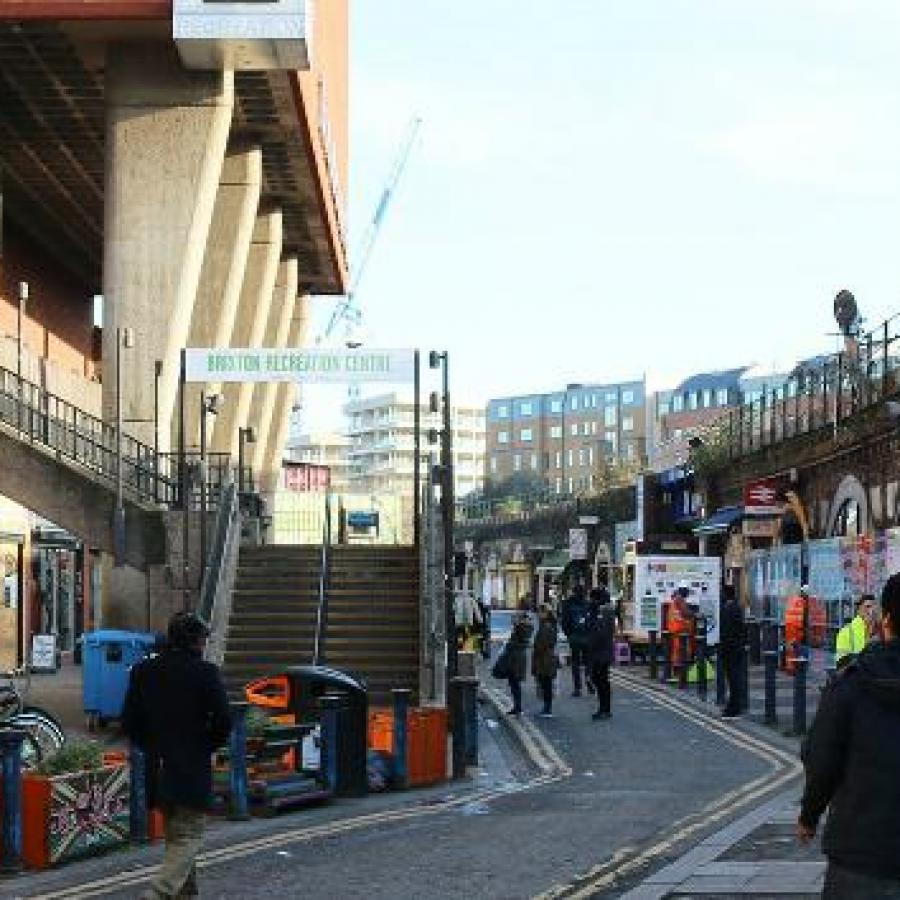 People walking through Brixton Station Road Market