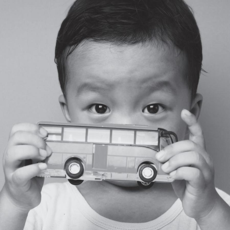 SEND local offer a child holding a toy bus